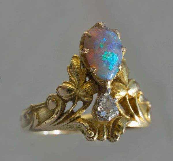 Art nouveau diadem ring, made of gold, opal, and diamonds. French, c. 1900